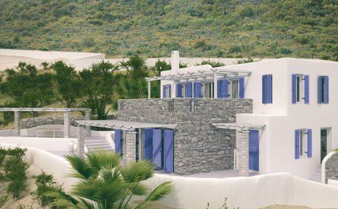 Νησιώτικο διοροφο με πέτρα και μπλε κουφώματα