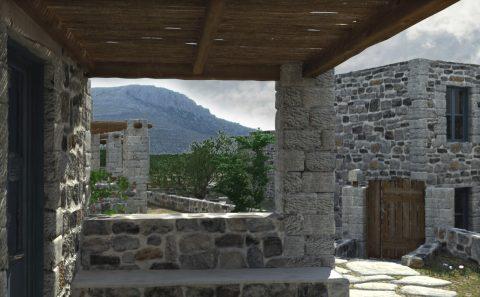 Σχεδιασμένη εικόνα θεας πέτρινων σπιτιών