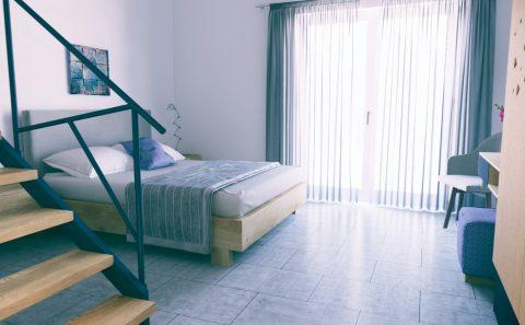 Εσωτερικό ενοικίαζομενων δωματίων φωτορεαλιστικο